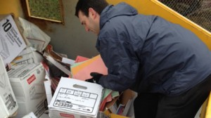 Indiana news reporter Bob Segall investigates patient records dumped in church recycling bin. Courtesy: WTHR-TV
